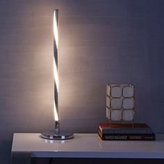 JONATHAN Y Chrome Nile LED Integrated Table Lamp This modern table lamp perfectly balances minimalism and distinctive design. The energy-efficient built-in LEDs cast a warm glow from the slim-line bar base. Led Floor Lamp, Cool Floor Lamps, Light Table, Lamp Light, Table Lighting, Bedroom Lighting, Light Art, Light Bulb, Unique Table Lamps