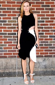 Diane Kruger is wearing a black/white color block Mugler dress with a side cutout and asymmetrical hemline. Diane's style is unique and all her own! She pushes the envelope. Adorable Alexandre Birman white ankle strap heels.