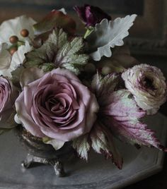Sterling Roses, Begonia Rex, and is that a lipstick I see in the back...doesn't matter because the whole arrangement is eerie and beautiful