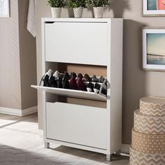 Keep your home organized by storing all your shoes in this uniquely stylish Simms cabinet.