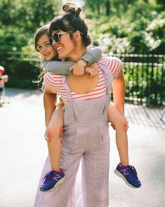 Reason 187 why we love jumpsuits: they're perfect for piggyback rides #regram @taza