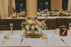 Table setting in Great Hall   Naturally Delicious Catering Rebecca Shepherd Floral Design