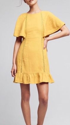 Two words describe what we feel for this dress: Simple Love. This mustard yellow linen dress has a hidden zipper closure and two tie closures on the back. The draped flutter sleeves give it the final