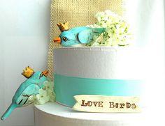 50 best wedding finds: #9 love bird wedding cake toppers (by indigo twin weddings) via Emmaline Bride