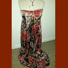 Maxi dress Silky maxi dress, brown, pink, and red from Maurices in new condition. With tie around the neck Maurices Dresses Maxi
