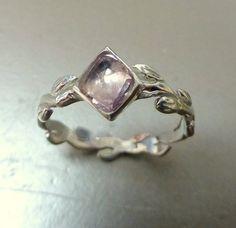 Rose cut engagement ring.  Light pink rose cut sapphire.  14k gold. $315.00, via Etsy.