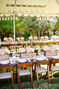 table settings, chandeliers, wood tables, centerpieces, flowers