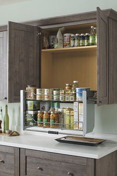 Our two-tiered Pull Down Cabinet Shelf brings items in wall cabinets within easy counter-level reach.