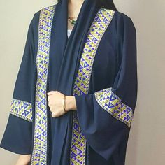 Classic abaya in dark blue with embroidered panels, side slits and a belt. Available online now Www.qabeela.biz