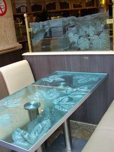 Sandblasted carved glass tabletop and railing by France Vitrail International http://www.france-vitrail.com/ http://www.ericbonte-maitreverrier.com/EN/