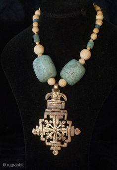 Old bronze Lalibela Coptic Cross from Ethiopia pendant insered on big olt amazonite beads from Sahara, contemporary ivory and blue dutch. Cross Size: 9 cm x 6 CM diameter of beads: 3 cm - 0,2 cm