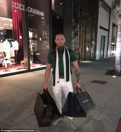 McGregor posted a picture of himself carrying a number of Dolce and Gabbana bags outside t...