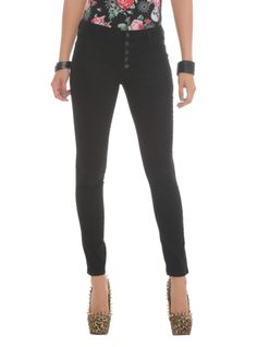 Black skinny jeans with a high waist and 5-button fly.
