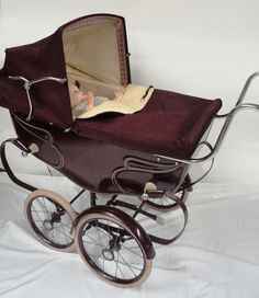 Tennants Auctioneers: Silver Cross Burgundy Painted Dolls Pram with cream leatherette lining
