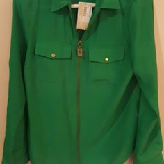 Michael kors zip up top Gorgeous Michael kors green zip up top size small. Your able to roll up the sleeve and snap them. Michael Kors Tops Blouses