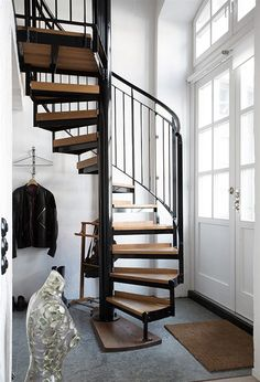 "Spiral stairs and double doors // Spiral staircases remind of of the opening of ""The Doris Day Show""! I loved that show and spiral staircases!"