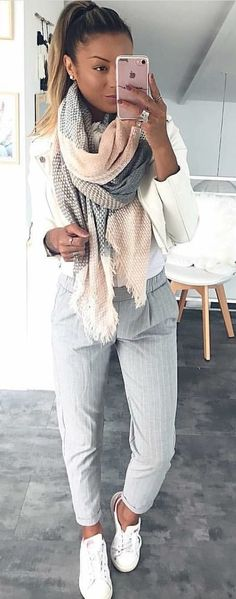 #spring #outfits woman wearing gray pants and white blazer holding rose gold iPhone 7. Pic by @fashiondemands
