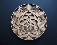 Gabriel Schama creates intricate wooden sculptures with laser-...