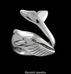 My BLUE WHALE RING is Inspired by The largest animal in the world. Blue Whales grow to over 100 feet in length and weigh up to 200 tons. This Bold Ring makes a state for the true WHALE LOVER. Hand Carved in Wax, cast into 925 Sterling Silver. hand sanded & Polished. Finished with a High Polish Shine. ON SALE! Marked Down from $140.   Weight 9.5 - 10 gm; Dimensions (in inches) .75 x .75 Adjustable, Available in sizes 7-12  Sterling Silver