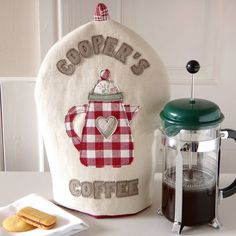 This gorgeous personalised cafetiere cosy is the perfect kitchen accessory for any coffee lover.To place an order: Please add your chosen words in the 'words above coffee pot' and 'words below coffee pot' boxes. Count the number of letters in these 2 boxes to work out the cost. For example: COOPER'S COFFEE = 13 letters and MR & MRS LEWIS = 11 letters. Words of up to 16 characters can be accomodated above the coffee pot, with words of up to 12 characters below the coffee pot. All letters…