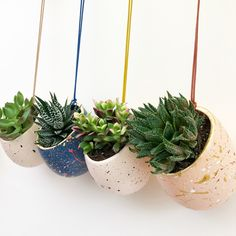 Our hand painted hanging ceramic planters have been painted using a splatter technique inspired by the colours and patterns of terrazzo, and complemented with a coloured leather cord.