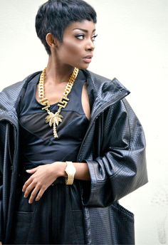 NYane Lebajoa's pixie haircut, gold chain, leather jacket