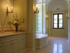 Soft golden hues, intricate molding and custom-designed mosaics make for a grand bathroom retreat. Streaming natural light and sconces add a subtle glow. Designed by Linda Maglia Bathroom Layout, Small Bathroom, Master Bathroom, Bathroom Ideas, Bathroom Designs, Bathroom Remodeling, Bathroom Flooring, Master Baths, Bathroom Makeovers