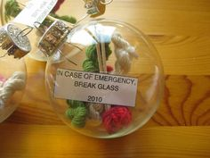 """In Case of [knitting] Emergency, Break Glass"" Christmas yarn ornaments."