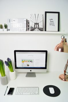 Scandinavian inspired home office. White desk, picture gallery and copper lamp. Perfect workspace.