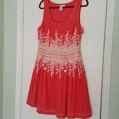 Beautiful dress Cute embroidery,  zipper on the side, washed once only, bust 19',  waist 15.5',  lenght 38'. Would fit a 12. Cotton, has a slip underneath. Coral color. Sophie Max  Dresses