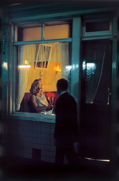 Elliott Erwitt. NETHERLANDS. Amsterdam. 1968. Red light district.