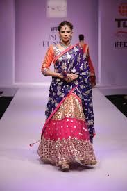 Orange and pink net embroidered lehenga with blue embroidered dupatta Orange and pink net Gota patti work embellished net Blue floral embroidered Comes with matching unstitched raw silk blouse material and georgette dupatta Indian Attire, Indian Wear, Indian Dresses, Indian Outfits, Fashion Shows 2015, Indian Bridal Lehenga, Desi Wear, Lehenga Designs, Indian Couture
