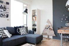 Cute minimalist Christmas tree... plank tree with shelves for ornaments :)