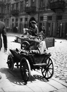 This man has lost both legs, thirty years ago in a Russian pogrom. Warsaw, 1937 .   His wife had died of a heart attack, but his small son had survived, and now was the bearer. Every day before going out in search of work, carrying his father on the street and gave him bread and water for the day. The evening brought back the old man to his house.