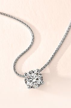 Celebrate Valentine's Day with this beautiful platinum pendant showcasing a 1.75 ct brilliant Blue Nile Signature Ideal Cut diamond.