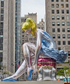 jeff koons inflates 45-foot-high seated ballerina in new york's rockefeller center