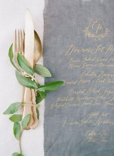 Gold Calligraphy Menu and Metallic Flatware   Feather and Stone Photography   http://heyweddinglady.com/sweetest-spring-wedding-palette-ever/