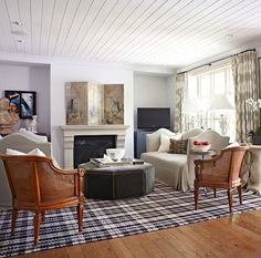 love the plaid rug and the ottoman
