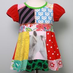 recycled tees dress... maybe I can use old onesies and make this.  So cute!