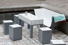 The pro­ject Art Square was launched in Kaunas, Lithuania in 2010. An aban­doned foun­tain from Soviet Union time was trans­formed into a social activ­ity pool for inhab­it­ants of the city. Design­ers used old baths and water­proof mater­i­als to cre­ate fur­niture and light­ing