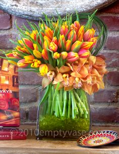 Orange/yellow tulips, brown orchids.