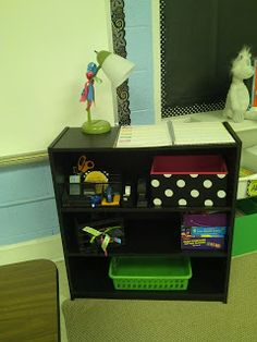 I like this idea. I have been thinking of getting rid of mt teacher desk but was wondering where to put my lesson plans.