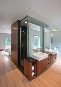 Beautiful Master Suite open floor plan. Love the bathroom vanity area with the shower behind the vanity  the bed facing the outdoor view!