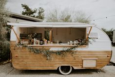 Rather than a bar, I'd like the caterer to have a cool nomadic trailer like this for food preparation and beverage service. food truck We're All About the Bridesmaids in White at this Moody Bohemian Wedding