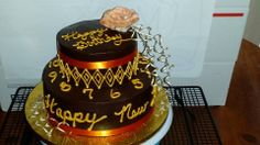 Chocoholics Dream - Chocolate cake with chocolate mousse covered in a chocolate ganache.  Birthday/Happy New Year cake.
