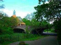 old bridge with green grass under it