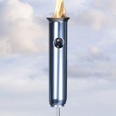 """Fiji Aluminum Propane Gas Tiki Torch - Olympic Style by Legends Tiki Lifestyle. $64.00. Material: Aluminum Metal. Fuel: 14.1 oz blow torch cylinder. Torch Head Size: 5"""" W X 16-1/4"""" H. Pole Height: 60"""". Total Height with Pole: 76-1/4"""". Add the romance of fire to your outdoor setting with the Fiji Aluminum Gas Tiki Torch.  The Fiji Gas Tiki Torch is easy to assemble and install. The flame height is adjustable and will burn for hours on a 14.1 oz propane blow torch cylinder..."""