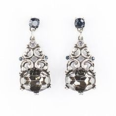 Royal-blue crystal earrings. Pepper Chocolate's royal-blue crystal earrings are inspired by vintage jewels. Wear this silver-plated pair with a sweater and jeans to work the brand's eclectic-chic ethos.