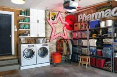 Amazing garage make over- love the wood lined walls and clean metal shelving. They used their old kitchen cabinets in the garage (with a fresh coat of white paint) for streamlined storage as well.