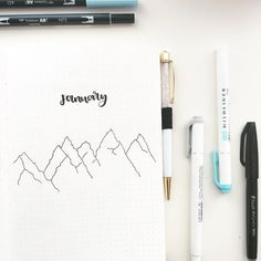 Bullet journal monthly cover page, mountain drawings, January cover page. | @alexscribbless